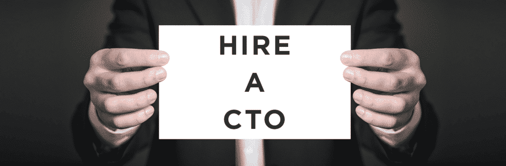 man holding a card that says hire a cto