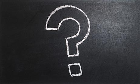 question mark written with chalk on a blackboard